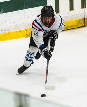 Hopedale's Brady Butler moves the puck during last year's Central Mass. Division 3A final against Lunenburg.