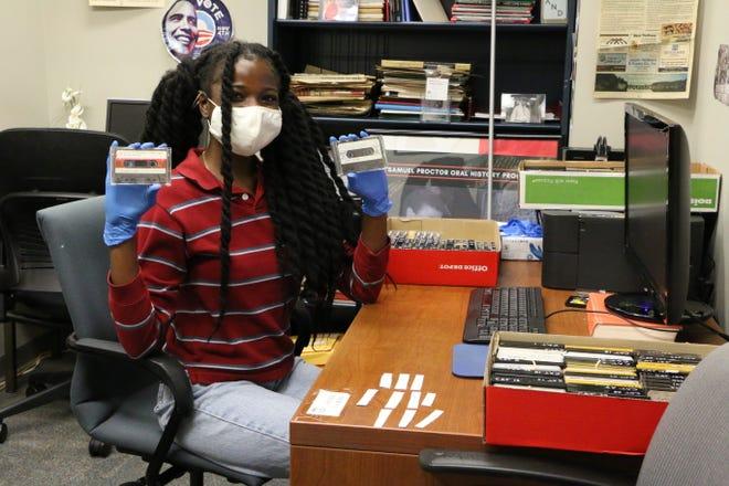 Jaime Douglas packs tapes of Catawba Indian interviews for digitization.