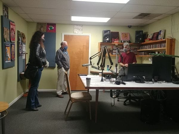 A trio of volunteers for the Justice Connection radio show talk programming