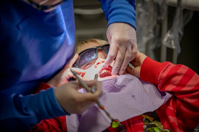 Noah Carson, 3, gives student Angel Hupcej a good look at his teeth at Gulf Coast State College on Tuesday, Feb. 16. The college's Dental Hygiene Program is hosting a Kidz Klinic in celebration of National Children's Dental Health Month. The clinic runs through Thursday.