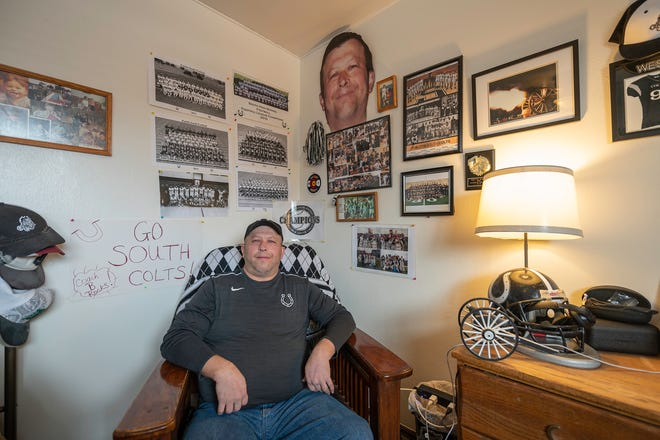 Brent West poses surrounded by some of his collection of South High School memorabilia on Tuesday February 16, 2021.