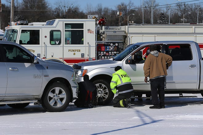 Fort Smith EMS and Fort Smith Fire Department at the scene of an accident, Tuesday, Feb. 16, in the intersection of US. 271 and U.S. 71 in Fort Smith. Motorists have been urged to use caution when driving on Friday asrefrozen snow is expected to create icy conditions on someroads.