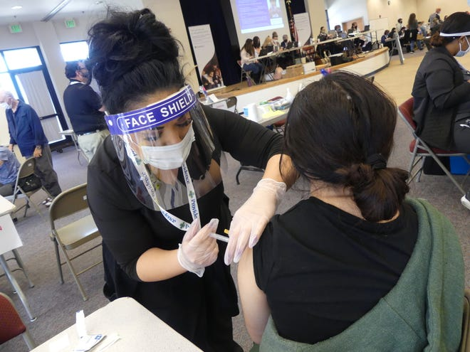 Victor Elementary School District teacher Ariana Aponte, 21, was one of 1,500 people who attended day one of the mass COVID-19 vaccination clinic at Our Lady of the Desert Catholic Church in Apple Valley.