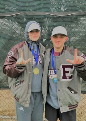 Ennis' Rylee Boston (left) and Nick Sinopoli display their medals for winning the Mixed B Doubles championship at the Corsicana tennis tournament last week.