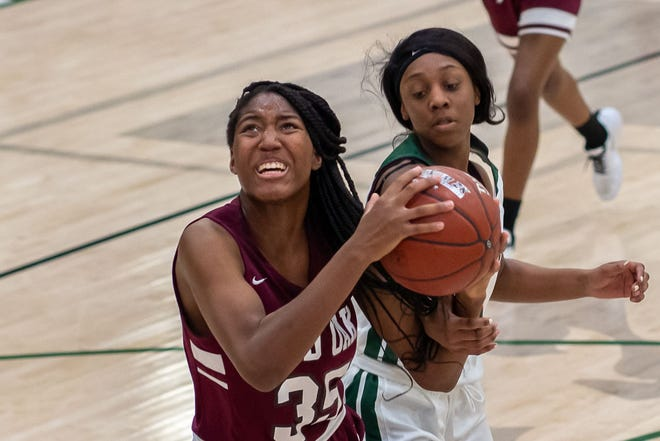 Red Oak's Aniyah Johnson (35) makes a move to the basket during a game against Waxahachie in this file photo. The Class 5A No. 19-ranked Lady Hawks opened the Class 5A Region II playoffs with a 57-41 win over Crandall on Friday night.
