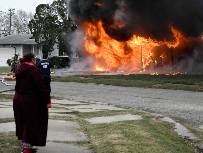 Corpus Christi firefighters respond to a residential fire on the 900 block of Collingswood, Tuesday, Feb. 16, 2021.