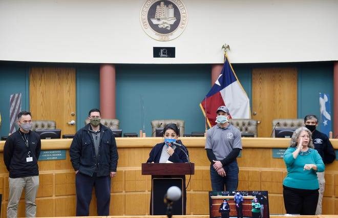 Mayor Paulette Guajardo, center, speaks at the city's press conference about the issued water boil, Tuesday, Feb. 16, 2021, at City Hall. The city is planning to have water distribution centers as well as partnering with the American Red Cross for homebound senior citizens.