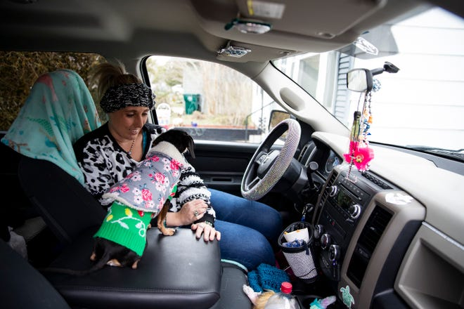 Laramie White and her dogs stay warm in her truck on Tuesday, Feb 16, 2021. Her home was among the thousands in Corpus Christi that were left without power after extremely cold weather moved through Texas earlier in the week.