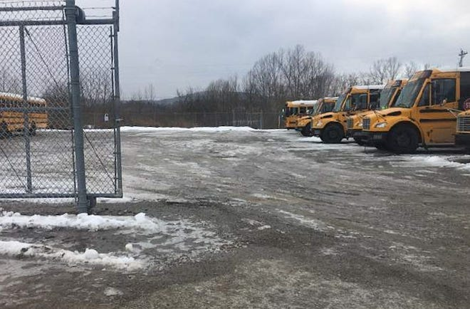 Ice covers the Paint Valley Local School District bus garage parking lot on Feb. 5, 2021. After two injuries, Ohio Association of Public School Employees Field Representative Sean Dahl alleges that the Paint Valley Local School District has unsafe working conditions and district administrators are failing to take corrective measures.