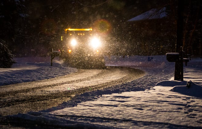 A snowplow driver in Blue Ash clears a side road, Tuesday, Feb. 16, 2021. Though we didn't get as much snow as expected, we got enough to close schools and make driving treacherous. Temperatures will stay in the low 20's, with the wind chill making it feel much colder.