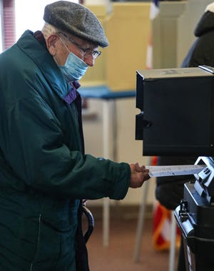 Robert Fink of Fond du Lac inserts his ballot to be counted Tuesday at Fond du Lac Fire Station 1 on South Main Street.