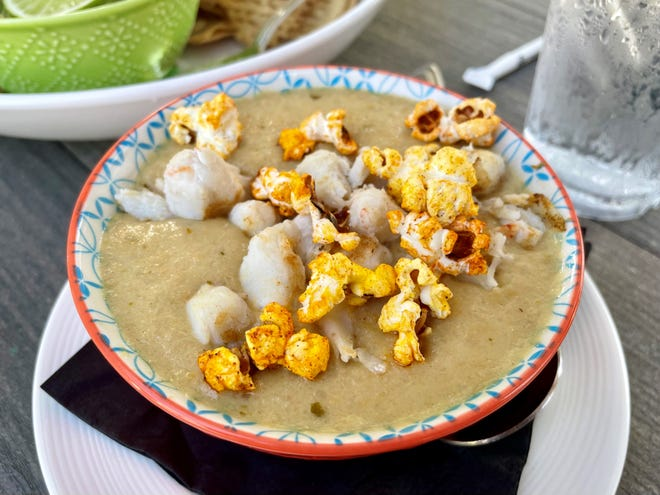 400 Rabbits crafts a crab-and-corn chowder with sweet corn, hominy, ancho chilies and lumps of seafood. Ancho-dusted popcorn finished the cup.