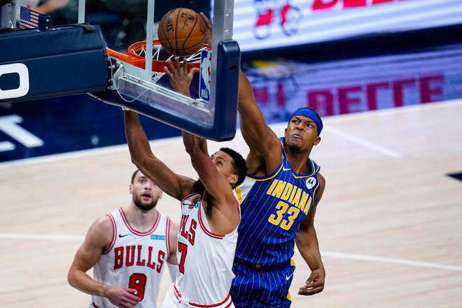 Indiana Pacers center Myles Turner (33) blocks the shot of Chicago Bulls guard Garrett Temple (17) during the first half of an NBA basketball game in Indianapolis, Monday, Feb. 15, 2021.
