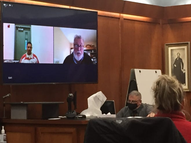 Defendant Quinton Davis appears by Zoom on Tuesday in Richland County Common Pleas Court. Defense attorney Steven Billing is to the right, with bailiff Chuck Kochis and First Assistant Prosecutor Jodie Schumacher in the foreground.