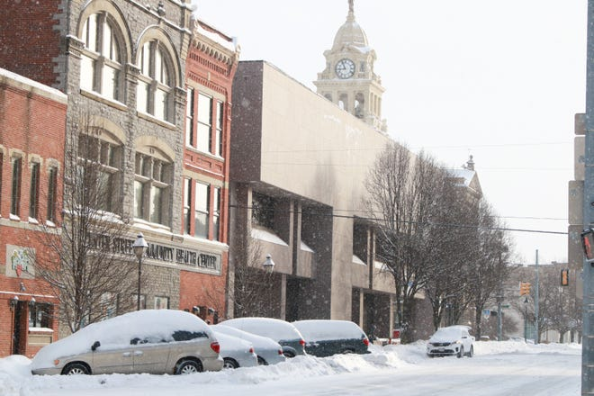 Downtown Marion is snow covered after a large snow storm comes through Central Ohio on Feb. 15, 2021.