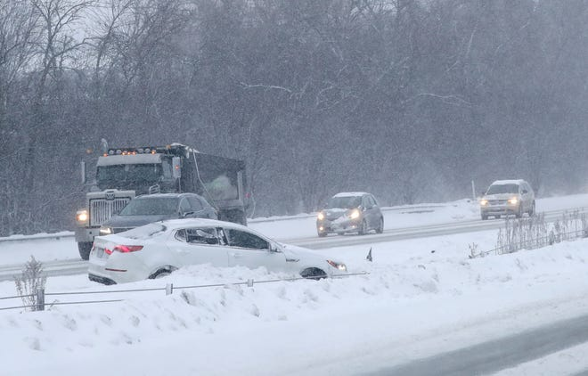 A car is stuck on I-43 northbound just north of Good Hope Road in Glendale on Tuesday.