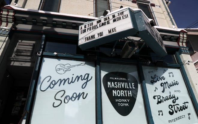 """A """"honky tonk"""" called Nashville North is promoted on posters on a building that formerly housed the Up and Under Pub, located at 1216 E. Brady St., Milwaukee, on Tuesday, Feb. 16, 2021."""