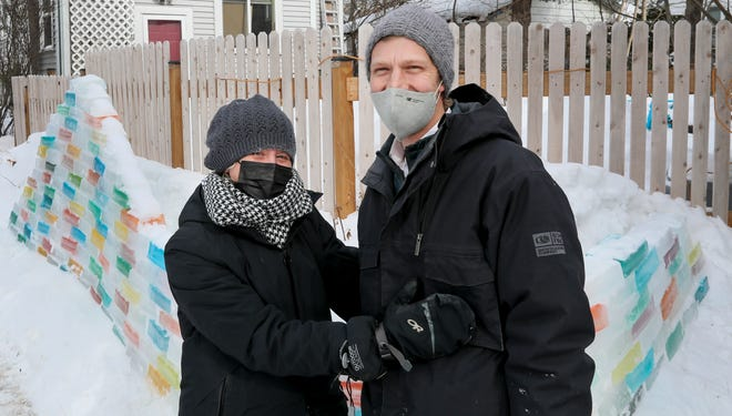 """Elizabeth Erbes and her boyfriend, Charles Graebner, have put in 20 hours of work building an ice wall in front of their home located 1603 E. Belleview Pl., on Friday, Feb. 15, 2021, in Milwaukee. """"Everyone in the neighborhood loves it,"""" Erbes said. """"There's one guy that says, 'I love it so much, it always keeps me going.'"""""""