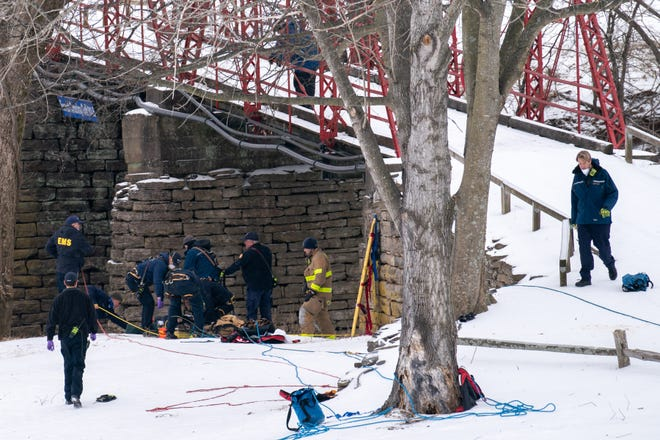 Firefighters work on hoisting up a woman who had fallen into the Harpeth River in the Forrest Crossing subdivision in Franklin, Tenn., Tuesday, Feb. 16, 2021. The Franklin Fire Department responded to a report of two people who were submerged in the Harpeth River.
