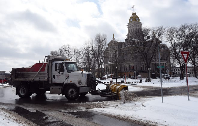 One of the roundabouts on the Second Street side of the Court House Square is plowed after noon of Tuesday, Feb. 16, 2021.