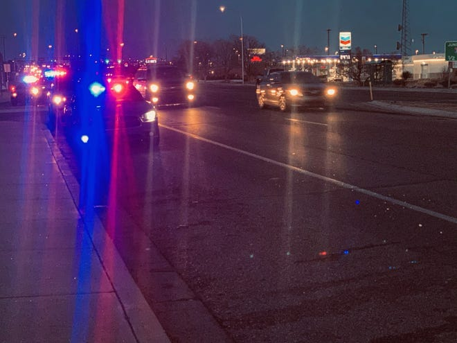 Las Cruces police respond to Sonic Drive-In, 2925 N. Main St., on Monday, Feb. 15, 2021, where a police officer was hit by a vehicle.