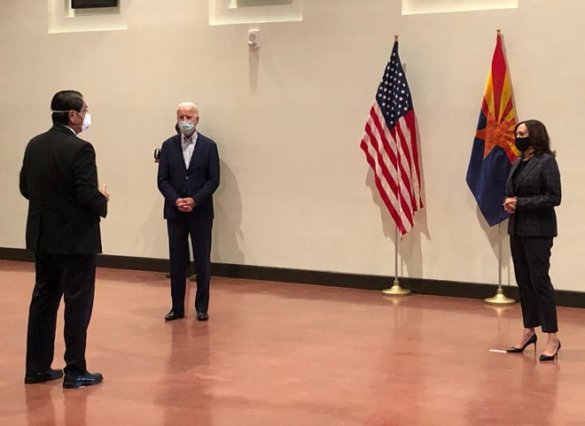 Navajo Nation President Jonathan Nez, left, speaks with then-presidential candidate Joe Biden and then-vice presidential candidate Kamala Harris in an Oct. 8, 2020 meeting with Arizona tribal leaders in Phoenix.