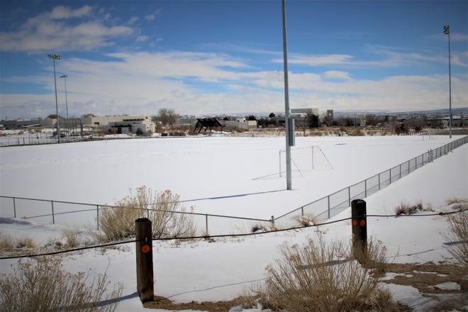 Snow blankets a soccer field at the north end of the San Juan College campus in Farmington on Feb. 16, 2021.