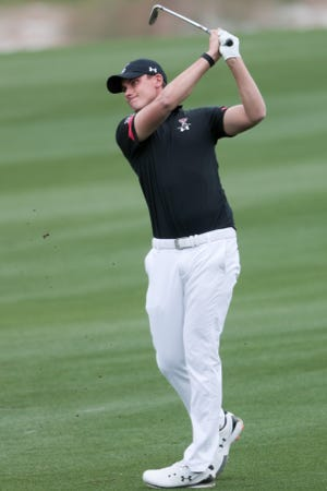 Texas Tech's Ludvig Aberg hits an approach down the eighth fairway during Monday's round of The Prestige golf tournament in La Quinta, California. Aberg was the 36-hole leader and finished in a three-way tie for the championship Wednesday.