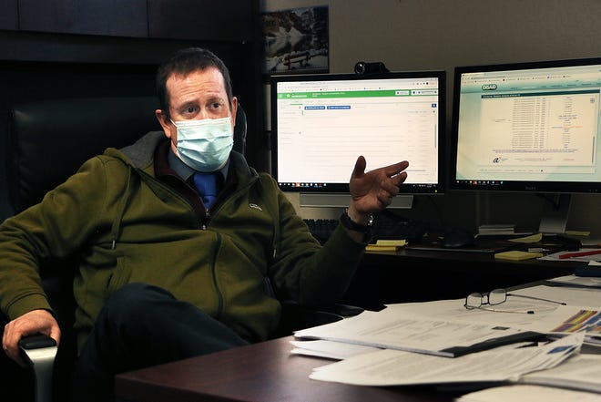 Dr. Mark Pandori, director of the Nevada State Public Health Laboratory, is seen in his office in Reno on Feb. 2, 2021