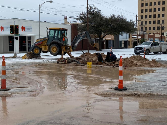 City crews work to repair a water main break at the intersection of Irving Street and Twohig Avenue on Tuesday, Feb. 16, 2021. Multiple water main breaks around the city prompted a boil water notice.