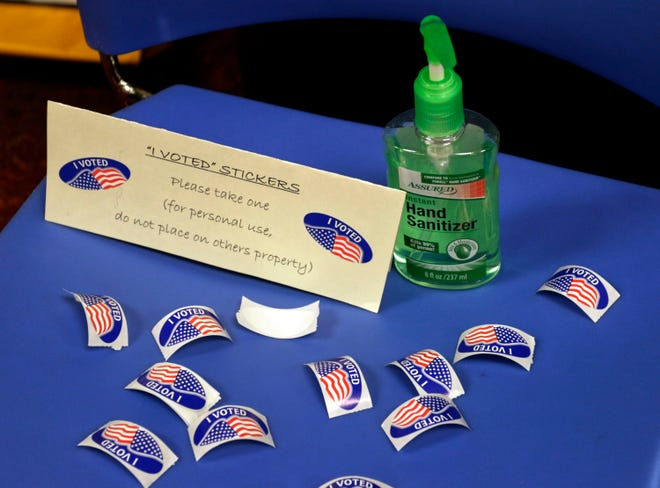 I voted stickers await voters Tuesday, Feb. 16, 2021, at Mead Library polls in Sheboygan, Wis.