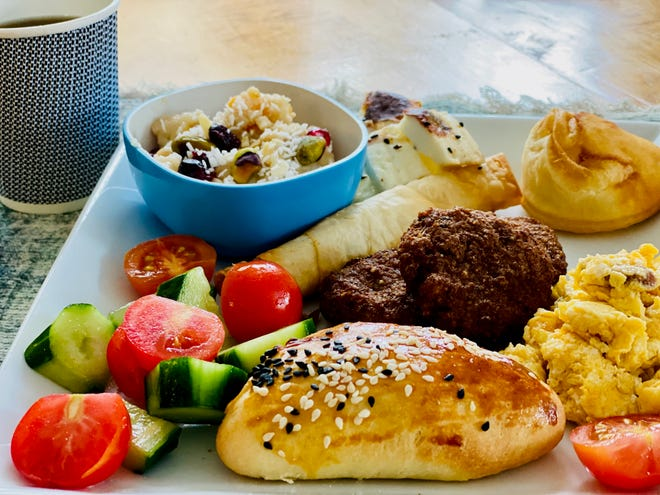 "Blue Turkey's Sunday brunch features a variety of baked goods (most filled with cheese),  eggs with Turkish dry sausage, turkey patties, olives, jams, grilled cheese, fresh sliced cherry tomatoes and cucumbers, ""Noah's pudding"" and Turkish Tea. There's also a vegetarian option."