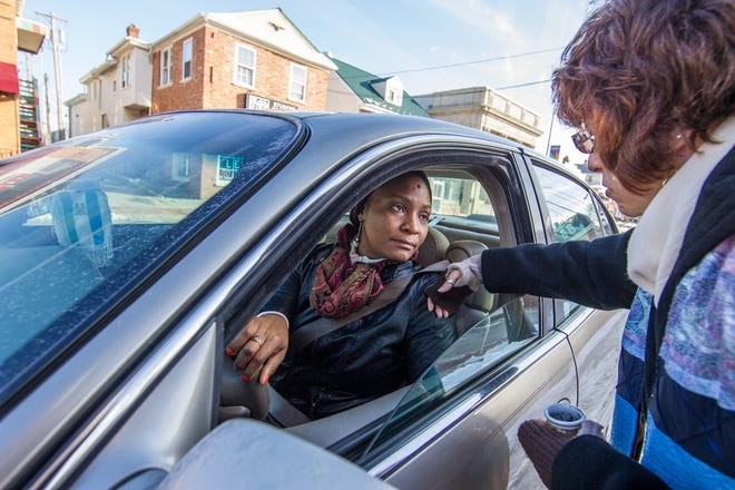 "In 2014, Rev. Cynthia Robinson offers Wachen Peters the Imposition of Ashes in her car in Newark, Delaware. Clergy from Newark Churches participated in the ""Ashes To Go"" movement to bring Ash Wednesday to those that are not able to attend a longer ceremony at a church."
