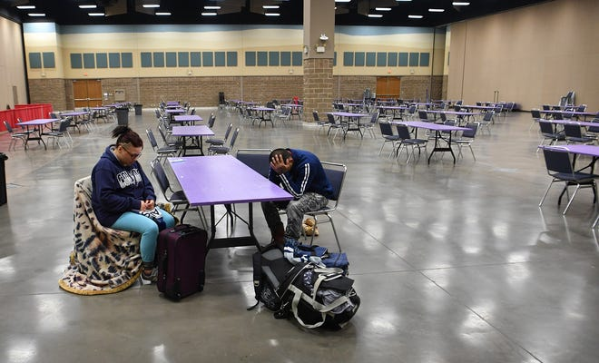 Mary and Angelo Diaz found themeselves stranded in Wichita Falls Tuesday afternoon on their way to McAllen, Texas. Snow-packed roads had delayed their bus so they sought shelter from the cold at a warming center set up at the MPEC.