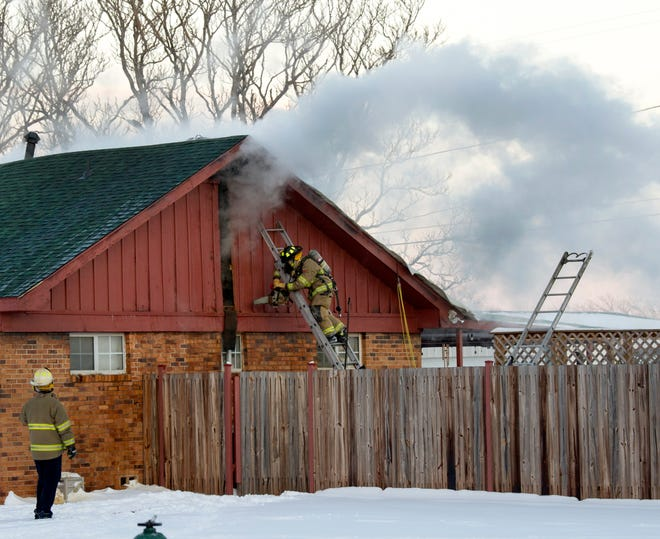 Wichita Falls Firefighters worked the scene of a two-alarm house fire Monday on Southeast Drive.