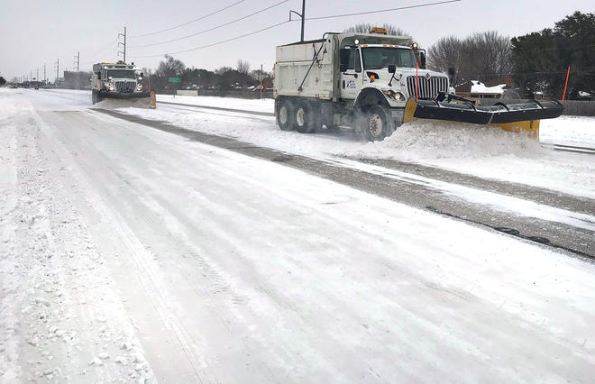 A TxDOT plow works to clear a section of Kemp Boulevard. Wichita Falls got a record-for-the-date 6.6 inches of snow Tuesday.