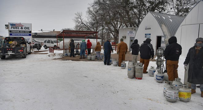 As electrical outages plagued the region, people lined up to buy propane fuel.