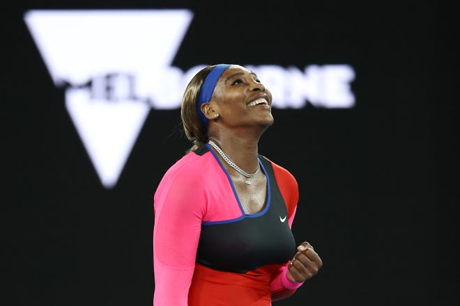 Serena Williams celebrates winning match point in her women's singles quarterfinals match against Simona Halep during the 2021 Australian Open at Melbourne Park on February 16, 2021.