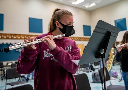 Karisa Peters, a senior at Carbondale Community High School, plays the flute while in band class on Jan. 29, 2021. The school has provided students with bell covers and specialized masks to limit the spread droplets that could be associated with spread of the novel coronavirus.
