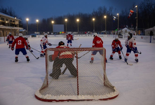 Players take part in the World's Longest Hockey Game near Edmonton. Forty players are taking part in the game that will last 252 hours to raise money for cancer research.