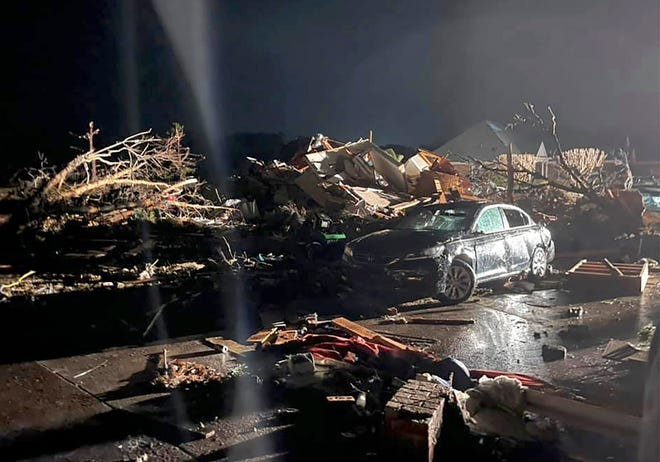 A damaged vehicle is seen among debris after a deadly tornado tore through Brunswick County, N.C., Feb. 16, 2021.  North Carolina authorities say multiple people are dead and others were injured after a tornado ripped through Brunswick County, leaving a trail of heavy destruction.