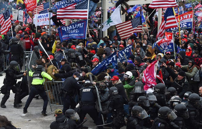 Trump supporters clash with police and security forces storm the US Capitol in Washington D.C on January 6, 2021.