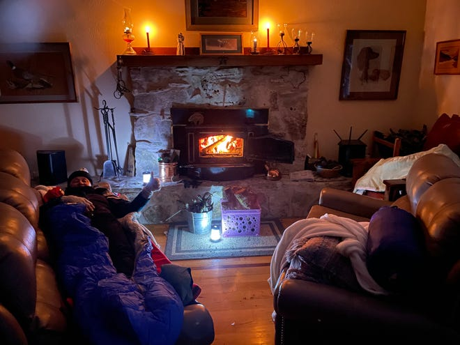 Terri Mitchell, who lives in the Homestead neighborhood in Bee Cave, has been bundled up in the living room with her husband without power or running water. Her house is 47 degrees. Luckily, she has a wood stove to use as a fire place.
