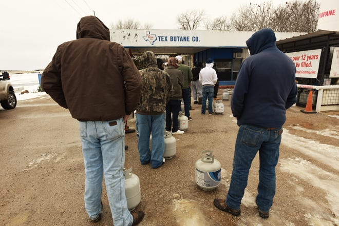 People lined up for propane at Tex Butane Co. in Bastrop on Tuesday as many residents were without power due to mandatory rolling outages. One man in line said it was the only store with available propane in town.