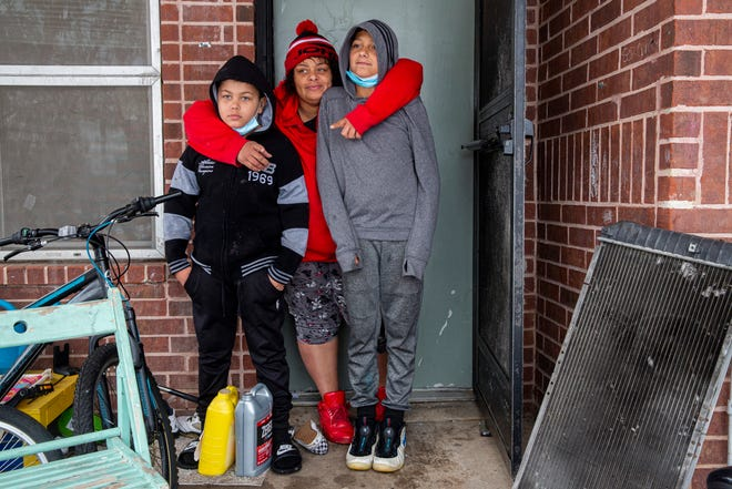 Heather Escobar stands with her sons Jeremiah Cavazos, 10, and Isaiah Escobar, 13. They had been without power for three days  on Feb. 17. Her only source of heat was a gas stove that she used to warm her home while living with her kids and mother.