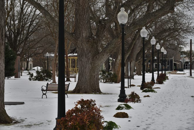 A snowy landscape takes over the Bastrop County Courthouse lawn and sidewalks after an Arctic winter storm on Feb. 14-15.