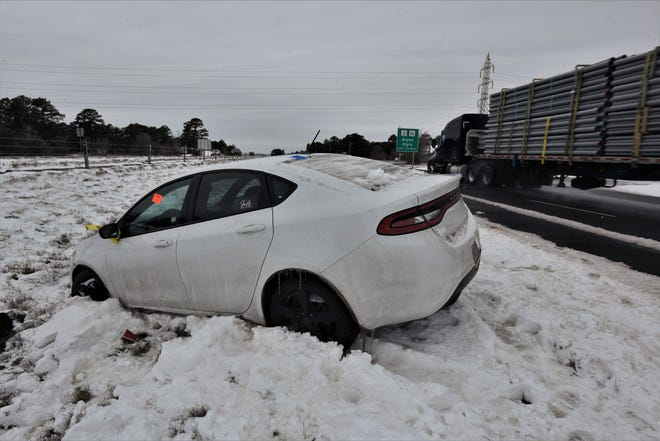 This white sedan vehicle was one of several to slide off Texas 71 in Bastrop due to ice after an Arctic winter storm dropped 4-6 inches of snow.