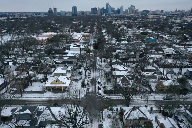 Snow and ice grips a neighborhood in East Austin on Tuesday, Feb. 16, 2021. Day six of the statewide freeze and still millions of Texans are without power.