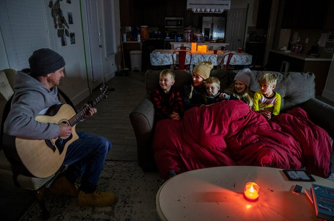 Brett Archibald tries to entertain his family as they try to stay warm in their home the BlackHawk neighborhood in Pflugerville, Texas on Tuesday, Feb 16, 2021 morning. Most homes in the area were without power for nearly 24 hours. Atmos Energy and other power companies were performing rotating outages to protect the electric grid.