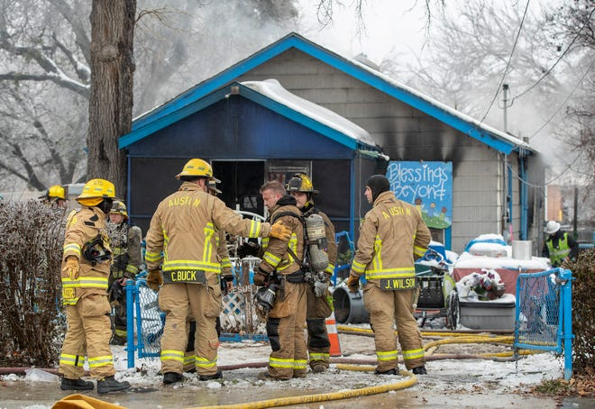 Austin firefighters work at the scene of a fire on East 12th Street where two people died on Wednesday February 17, 2021.